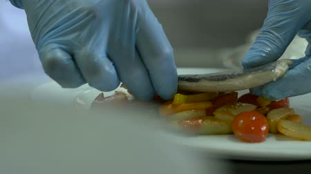 salt bed : chief baked fish with vegetables on white a plate Stock Footage