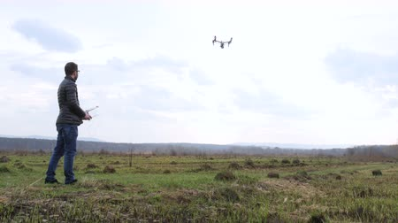 stable fly : man control drone flies in the white sky background Stock Footage