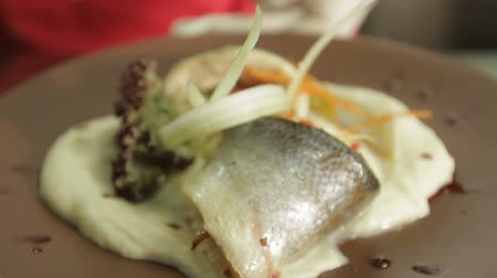sightly : Chef serves fish and mashed potatoes Stock Footage