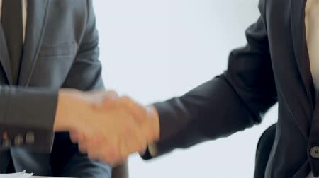 resourceful : Close-up of shaking hands seated companions Stock Footage