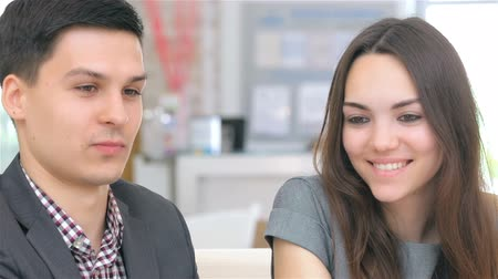 resourceful : Close-up of face, young attractive couple consults about their business project Stock Footage