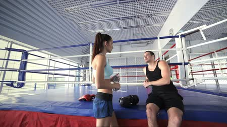 atleta : Young and successful boxing coach welcomes female athlete Stock Footage