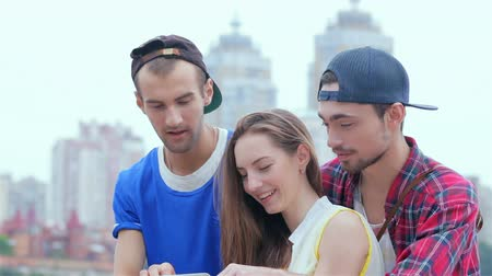 self portrait photography : Friends help the girl deal with the tablet Stock Footage