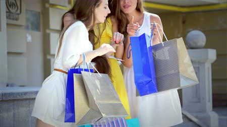 еще : The girls look at packages with fashionable things and decide where to go yet
