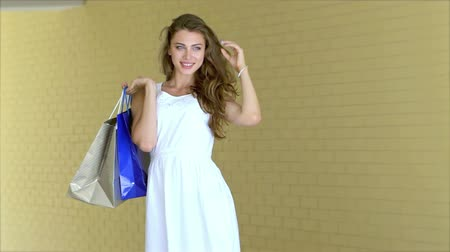 clothing : Graceful beautiful girl posing with trendy shopping while shopping