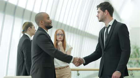 projects : Handshake between two businessmen Stock Footage