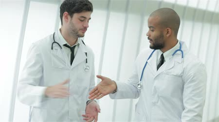 przychodnia : Two Young Doctors Do Handshake