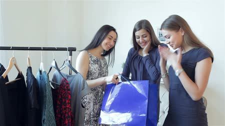 alışveriş : Girls take a look what I purchased. Girls choose dresses fashion boutiques. Emotionally discuss new things and discounts. Girl friends having fun together.