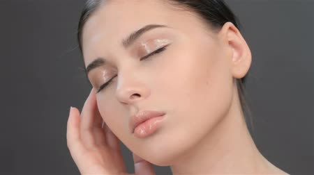 уход за кожей : Close up of brunette girl with closed eyes