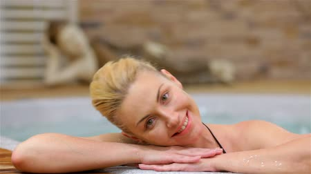 hot tub : Girl smiling happy at camera during relaxing