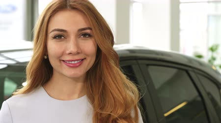 лошадиная сила : Selective focus on the car keys beautiful happy woman is holding out to the camera happiness driving ownership buying auto travelling consumerism rental service close up transportation.