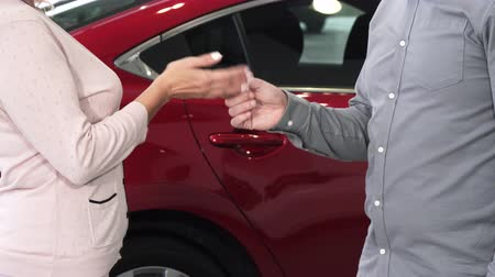 close cropped : Cropped shot of a woman buying a new car at the dealership receiving car keys automobile transportation vehicle driving license safety purchase consumerism customer sale offer.