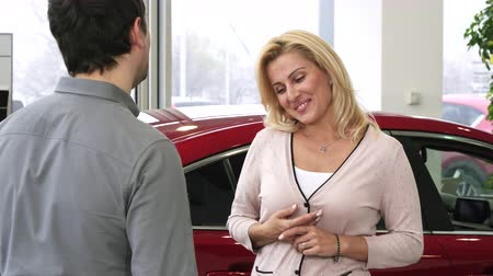 loans : Happy beautiful woman smiling excitedly receiving keys to her new car her husband buying for anniversary happiness emotions driving celebration present gift family love couples automobile.