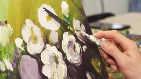 шедевр : Cropped close up of a professional artist working at his Art Studio finishing his artwork drawing beautiful flowers hobby equipment colorful picture oil paint brush palette lifestyle creative concept. Стоковые видеозаписи