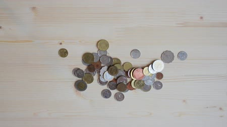 stash : Female hands open a jar and pour out coins on wooden table Stock Footage