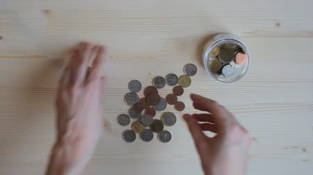 stash : Girl put coins in jar