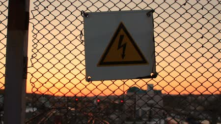 electric : High voltage danger sign on a lattice over railway yard station, warning