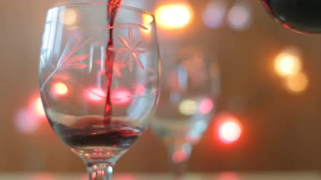 цвет бордо : Red wine poured into glass. Two glasses, lights background