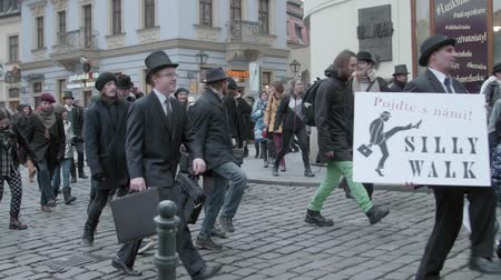 škádlení : Brno, Czech Republic – 01072019: International Silly Walk Day. Banter march of fooling walks. Joky procession of citizens having fun with up-and-down gait. Quaint way of walking people in street