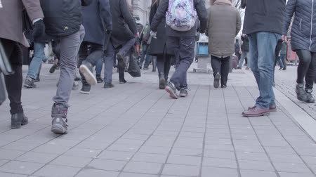 procession : Brno, Czech Republic – 01072019: International Silly Walk Day. Legs of walkers on banter march. People feet quaint way of fooling walking in street. Joky procession of citizens with strange gait