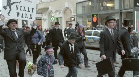 škádlení : Brno, Czech Republic – 01072019: International Silly Walk Day. People walking on banter march. Funny procession of citizen having fun with up-and-down gait. Feet with quaint way of walking in street