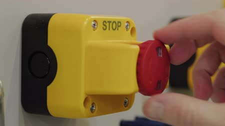 emergency stop : Palm pressing red stop button, hand reset emergency signal. Stopping industrial process. Pushing alarm button, turning it back. E-stop button on factory production. Press of red buzzer, distress siren Stock Footage