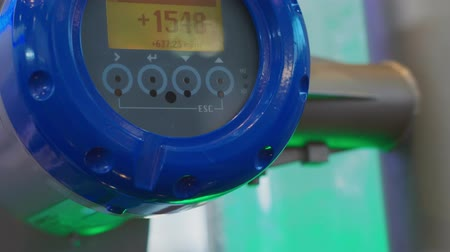 kanalizace : Blue flowmeter with density and speed values. Water counter meter for utility applications and energy management systems. Gauge for liquid, wet gas, saturated and superheated steam. Modern technology