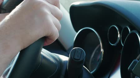 changer : Hand on steering wheel, changer and car dashboard during automobile driving on highway at day. Focus on hand, wheel, shifter, dashboard. Vacation, weekend concept. Sitter perspective inside of car Stock Footage