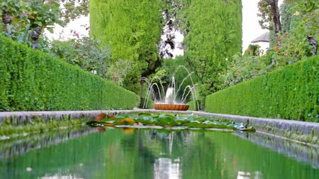 província : Working small fountain in park of Granada, Spain