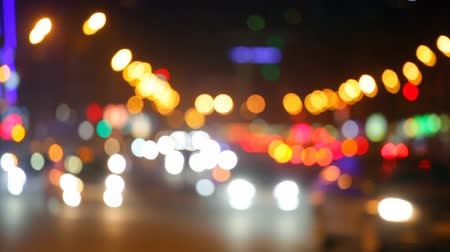 City at night background with cars. Out of focus background with blurry unfocused city lights. Moscow, Russia