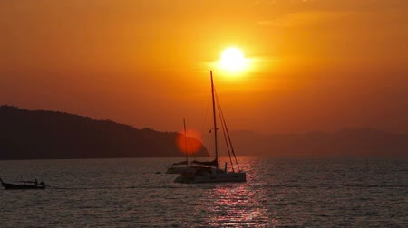 Пхукет : Sailing yacht illuminated by the light of the sun setting Стоковые видеозаписи