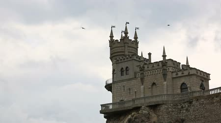 kayalık : Birds fly over castle Swallows Nest in Yalta, the Crimea Stok Video