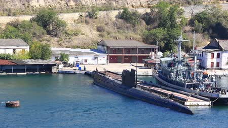 tenger alatti : submarine and the warship on the anchor parking in a bay of Sevastopol