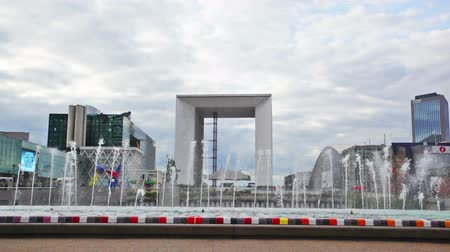 arche : Cloudy view at playing fountains near La Grande Arche in business district of la Defense at west of Paris.