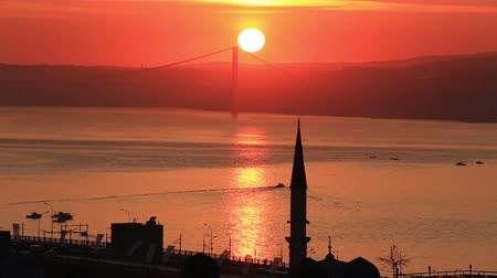 escarlate : Scenic sunrise view at the Bosphorus and silhouettes of Istanbul, Turkey