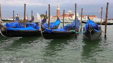 Image with Gondolas on the dock of Piazza San Marco. This is Venice international landmark of Italy