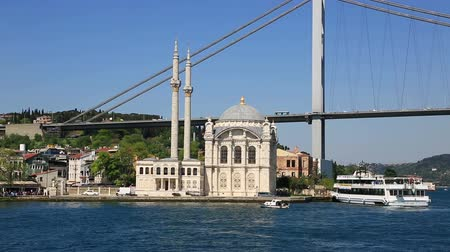 Scenic view at yachts on pier near Ottoman Neo-Baroque style Ortakoy Mosque and Bosphorus Bridge at distance Vídeos