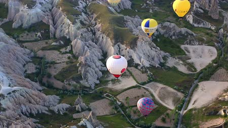 Multi-colored balloons in the sky of Cappadocia at sunrise, Turkey