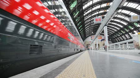 Milan, Italy - May, 7, 2014: High-speed train arrived at Milan Railway station. This type of trains on certain sections of the route reaches a cruising speed of 360 km  h. Vídeos