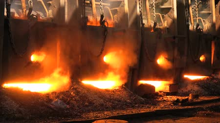 The metal is melted in the fiery furnace at the metallurgical plant
