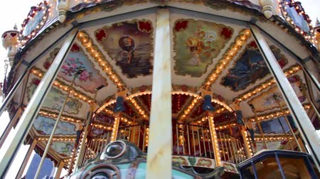 Swirling vintage carousel with horses and balloons Vídeos