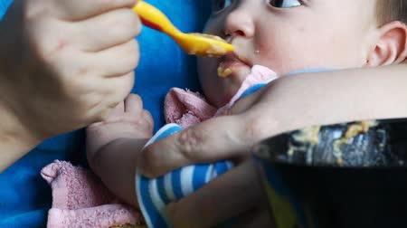 healthy eating : mother feeds newborn baby