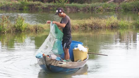 fishing industry : Fisherman pulling in his net