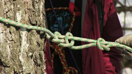 tying : Man tying a knot in a climbing rope Stock Footage