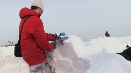 "igloo : NOVOSIBIRSK, RUSSIA,  - February 07, 2015: Festival Igloo-2015"". Man Builds A Snow House - Igloo"""