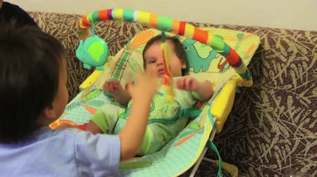 transportar : Cute Baby In His Chair Stock Footage
