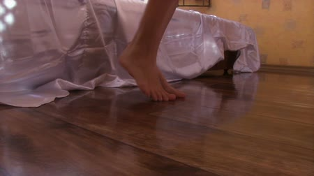 ayaklar : Young beautiful woman gets out of bed. View of the feet close-up