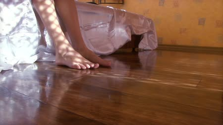 проснуться : Young beautiful woman gets out of bed. View of the feet close-up