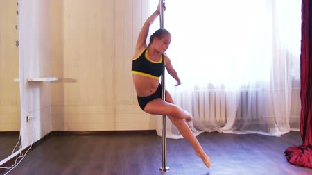 kutup : young beauty girl training pole dance Stok Video