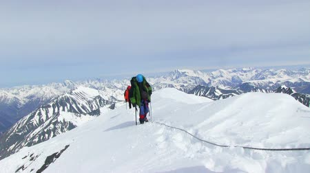 alpinista : Iiktoo mountain, South Chui range, altitude 4000 m. Climber rises on a steep mountain snow slope.